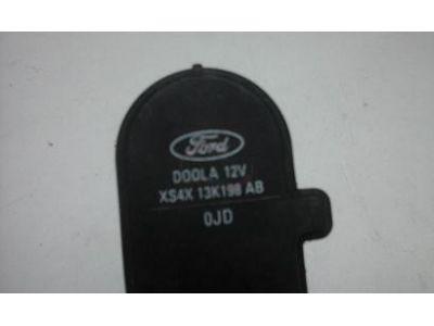 Ford Focus I - Afinador corrector de farol eléctrico